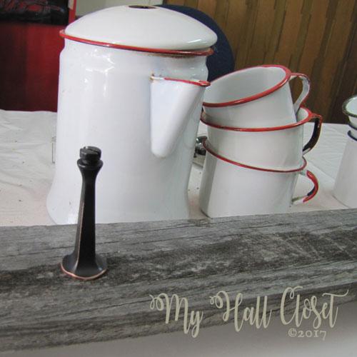 Door stop for coffee pots in place