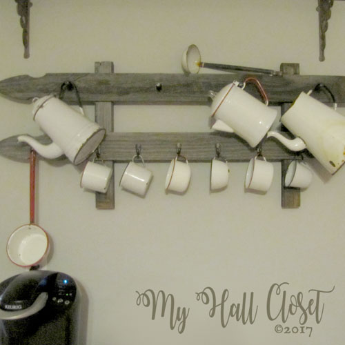 Rustic coffee cup rack with white enamelware coffee cups and coffee pots coffee