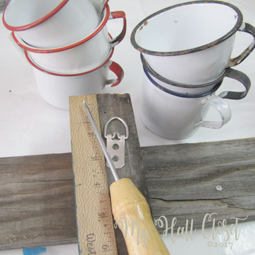 Attach hangers strong enough to hold the weight of the rustic coffee cup rack