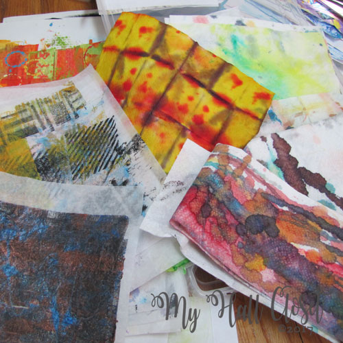 Stash of mixed media papers: stenciled, stamped, painted, dyed, watercolor