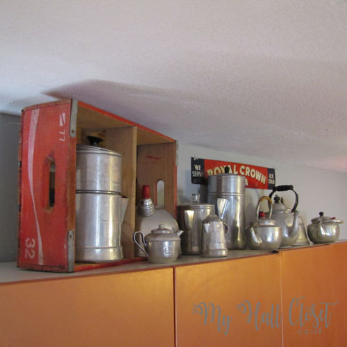 Collection of aluminum pots with vintage coke box