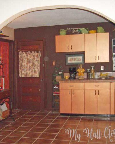 New tile, countertop,oil rubbed bronze faucet, brown walls, copper gleam, arch doorway