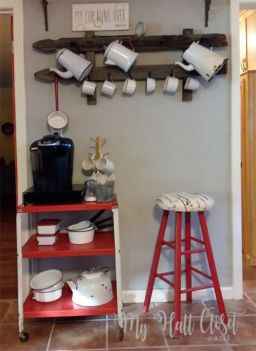 coffee wall with enamel pots