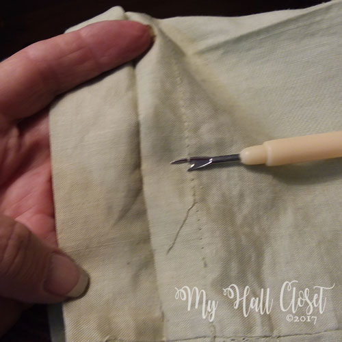 To alter pants with a cuff - remove hem stitching