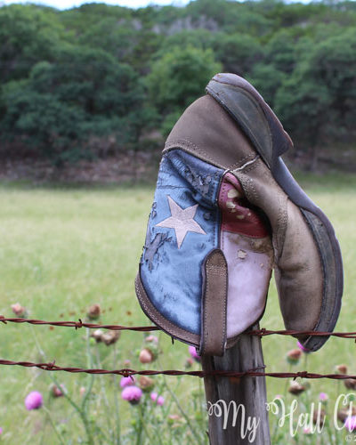 Texas Cowboy boot on Texas Hill Country fence