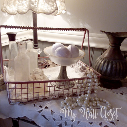 cabinet top decorated with vintage treasures