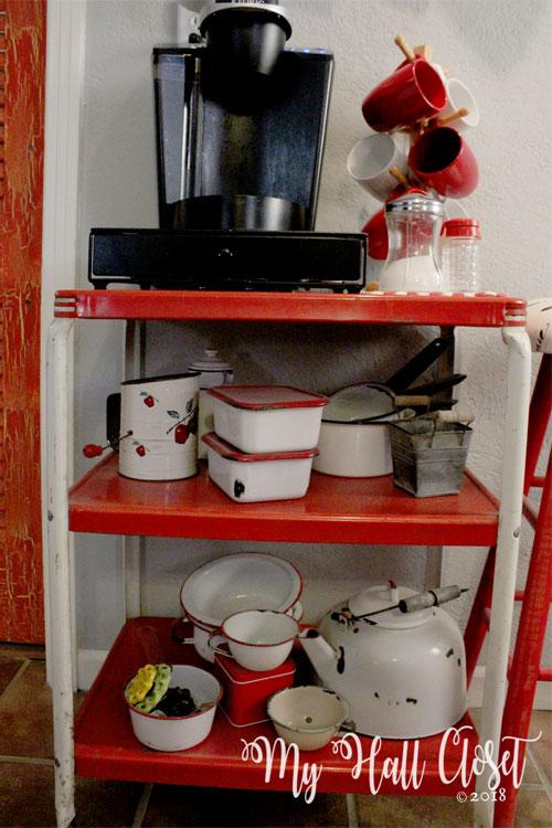rustic coffee station with vintage enamelware displayed