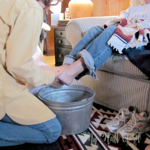 Friends wash each other's feet