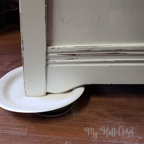 prop the legs on a disposable plate to protect the floor