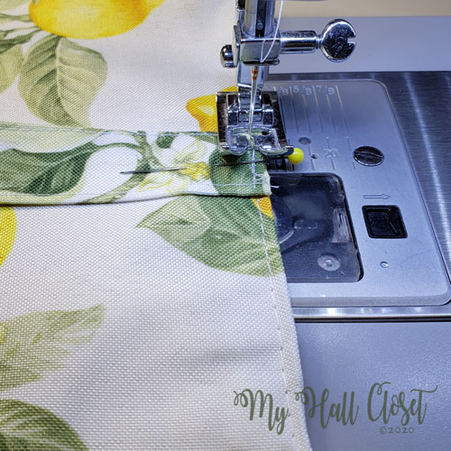 Stitch the handles in place Lemon Bag