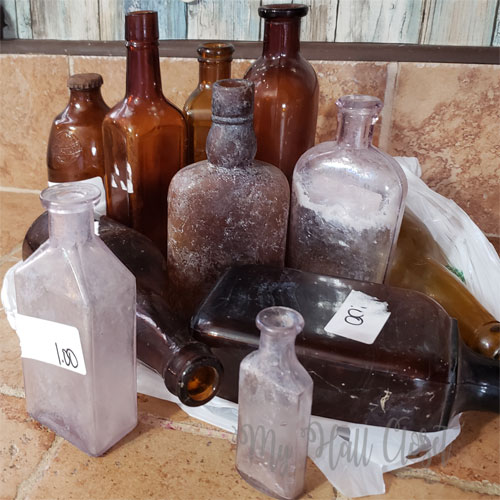 Brown and purple antique bottles